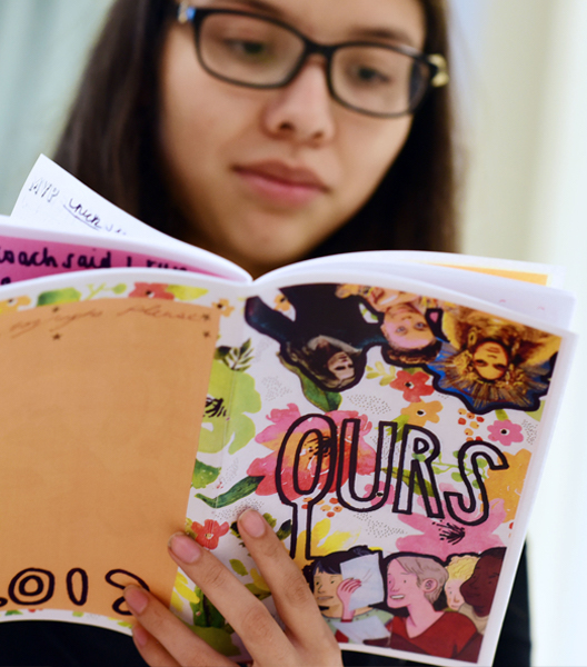 Student reading a zine at Newcomb Summer Session